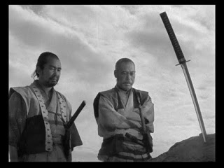 Two of seven samurai mourn a loss.