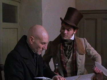 Actor Patrick Stewart plays Scrooge and Dominic West plays Scrooge's nephew, Fred, in the 1999 TNT adaptation of A Christmas Carol.